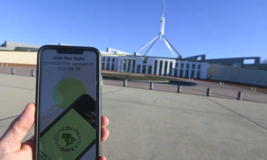 An iPhone displays the Covidsafe coronavirus contact-tracing app in front of Parliament House in Canberra. Labor wants the app's contract with Amzon to be cancelled and handed to an Australian cloud provider instead, which would move the data further from US law enforcement grasp.
