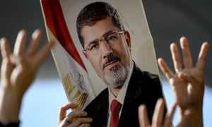 People attend symbolic funeral ceremony for Mohamed Morsi in Istanbul.
