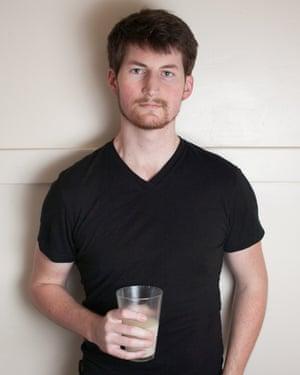 Rob Rheinhart and a glass of his creation, Soylent.