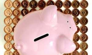 pink piggy bank with penny pieces