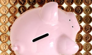 A piggy bank on some 1p coins