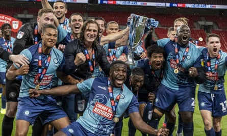Wycombe's players and manager celebrate their League One play-off final victory over Oxford at Wembley in July