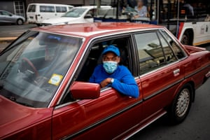 A man in Johannesburg wears a face mask amid concerns over the spread of Covid-19 in South Africa