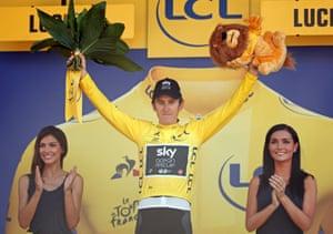 Geraint Thomas celebrates on the podium.