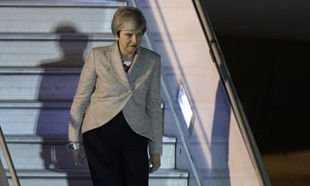 Theresa May steps off her plane upon arrival at Ezeiza International airport in Buenos Aires