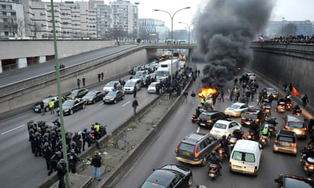 Taxi drivers demonstrate by blocking traffic and burning tyres on a ring road in Paris