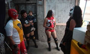 Lucha Libre wrestlers wait for their turn to perform.