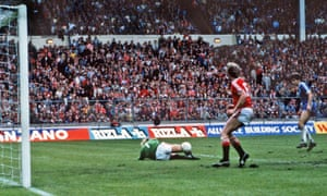 Brighton's Gordon Smith (far right) is foiled by the Manchester United goalkeeper, Gary Bailey, in the last moments of extra time during the first final.