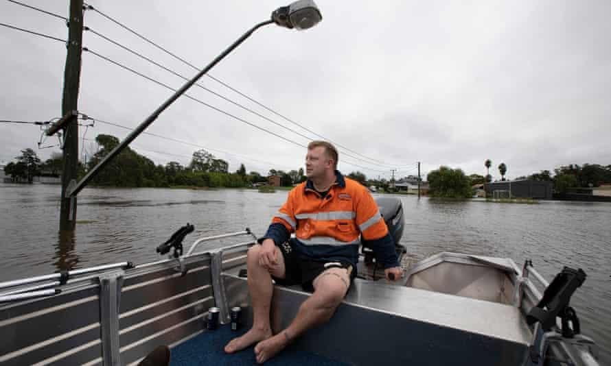 Dane Kemp pulls his gloomy through an area where the main road to Pitt Town normally runs