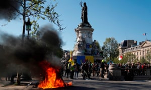 A fire burns at the Place de la République during an anti-government demonstration by the gilets jaunes movement.