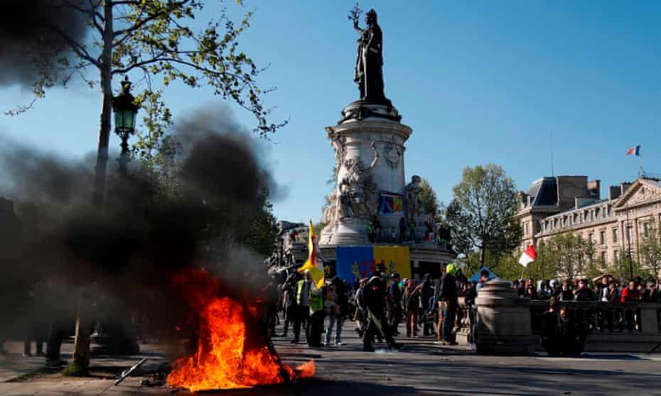 A fire burns at the Place de la République during an anti-government demonstration by the gilets jaunes movement.