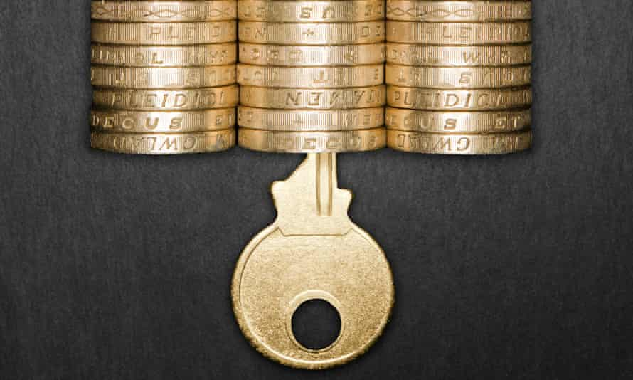 Padlock made from pound coins with a gold key inserted