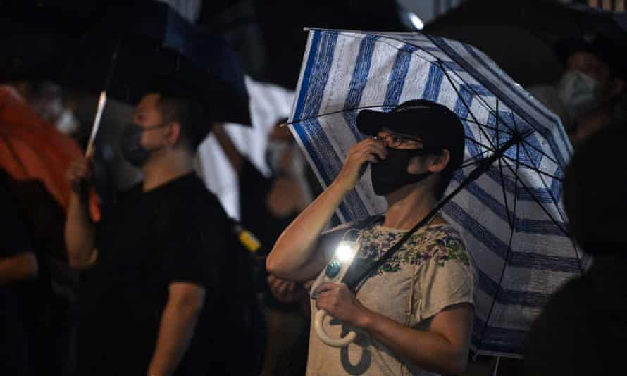 Supporters gather outside the Apple Daily offices on Wednesday