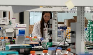 Research associate Phuong-Danh Tran, of Arcturus Therapeutics, conducts research on a Covid-19 vaccine in San Diego, California