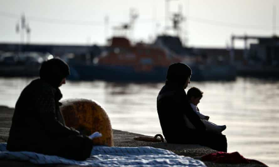 Women sit at Chios port