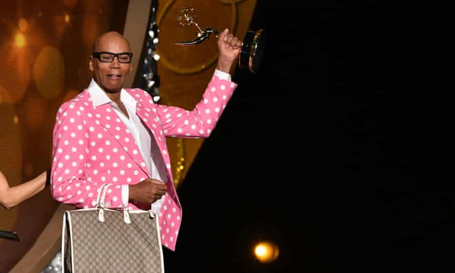 Emmys realness: RuPaul snatches his award.