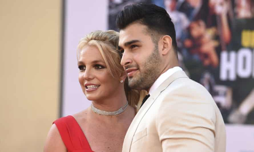 """Britney Spears,Sam AsghariBritney Spears and Sam Asghari arrive at the Los Angeles premiere of """"Once Upon a Time in Hollywood,"""" at the TCL Chinese Theatre, Monday, July 22, 2019. Spears announced on Instagram on Sunday, Sept. 12, 2021, that she and Asghari are engaged. The couple met on the set of her """"Slumber Party"""" music video in 2016. (Photo by Jordan Strauss/Invision/AP, File)"""