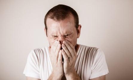 A man sneezing