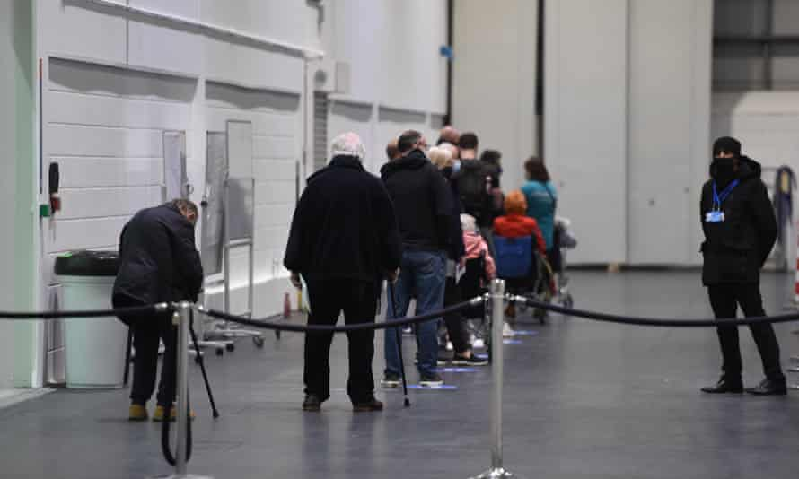 Queue for a jab at The Excel Vaccination Centre, east London