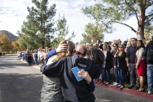 Students reunite with their families after the shooting at Saugus high school.