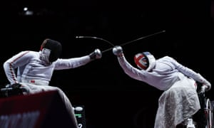 Dimitri Coutya of Britain in action against Andrei Pranevich of Belarus in their men's individual epee - Category B bronze medal bout.