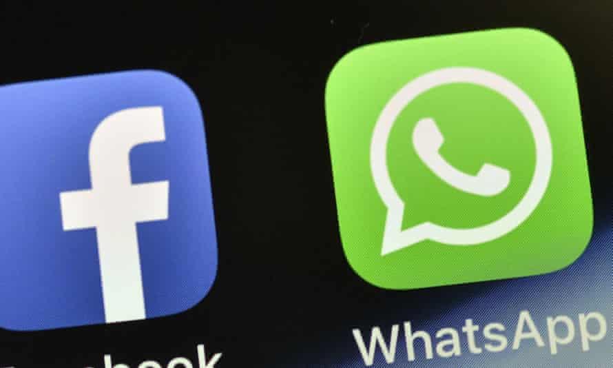 A WhatsApp icon on a phone