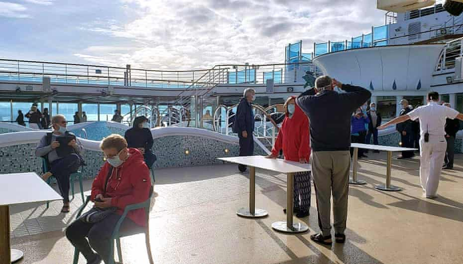Passengers wear masks on the deck of the Grand Princess cruise ship.