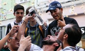 Football fans drinking alcohol in Nikolskaya Street, central Moscow