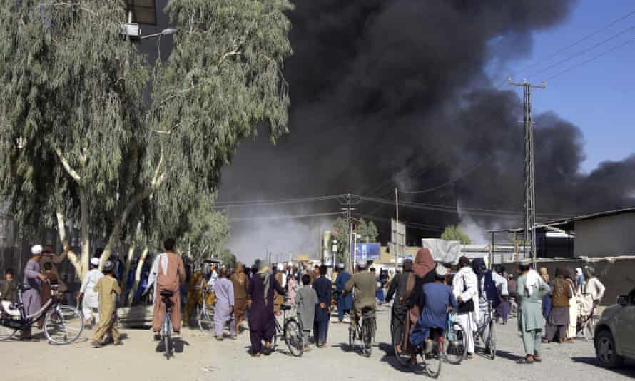 Smoke rises above Kandahar after fighting between the Taliban and Afghan security forces