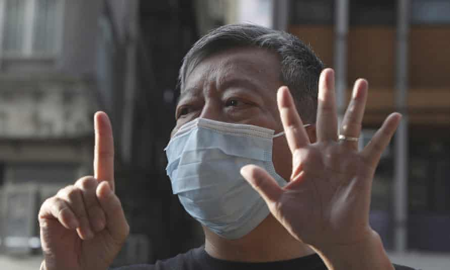 Hong Kong pro-democracy activist Lee Cheuk-Yan gives the 'five demands, not one less' hand sign. Zoom has admitted it disrupted activists' meetings at the behest of the Chinese government.