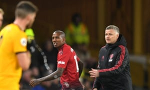 Ole Gunnar Solskjær consoles Ashley Young after the defender was sent off in Manchester United's defeat at Wolves