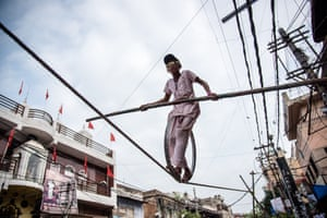Delhi, IndiaManisha, a young Indian girl, makes a living of up to 2,000 rupees (around £24) a day performing her tightrope circus skills above the street