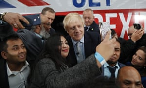 Boris Johnson posing for pictures at his battlebus launch.