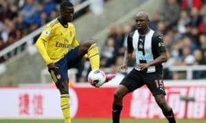 Nicolas Pépé, who came on as a substitute for Arsenal with 20 minutes left, looks focused and composed as Newcastle United's Jetro Willems closes in.