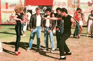 Olivia Newton-John as Sandy in Grease, with Putzie (Kelly Ward), Doody (Barry Pearl), Sonny (Michael Tucci) and John Travolta as Danny.