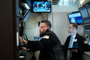 Traders work on the floor of the New York Stock Exchange .