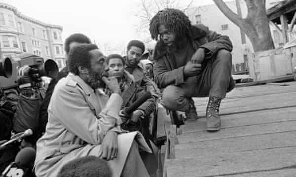 Dick Gregory, the political satirist and activist, in front of the MOVE headquarters in Philadelphia, 10 March 1978. Gregory tried to mediate the long standoff between the city and the radical group.