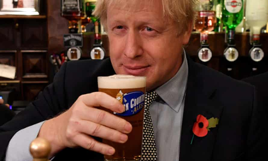 Boris Johnson holds a pint