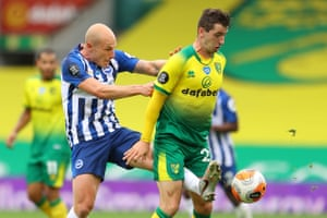 Brighton's Aaron Mooy (left) vies with Norwich's Kenny McLean.