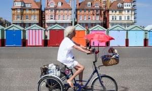 A woman rides a bike in Hove, Brighton.