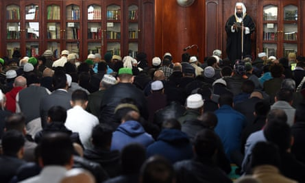 Muslims pray at Birmingham central mosque after observing a minute's silence for victims of the Westminster attack.