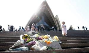 Flowers and a glass of beer left on the steps of the Sydney Opera House in tribute to Bob Hawke