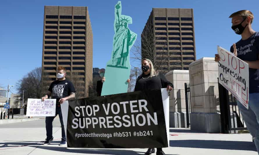 Demonstrators attend a protest against voter restriction laws outside the Georgia state capitol.