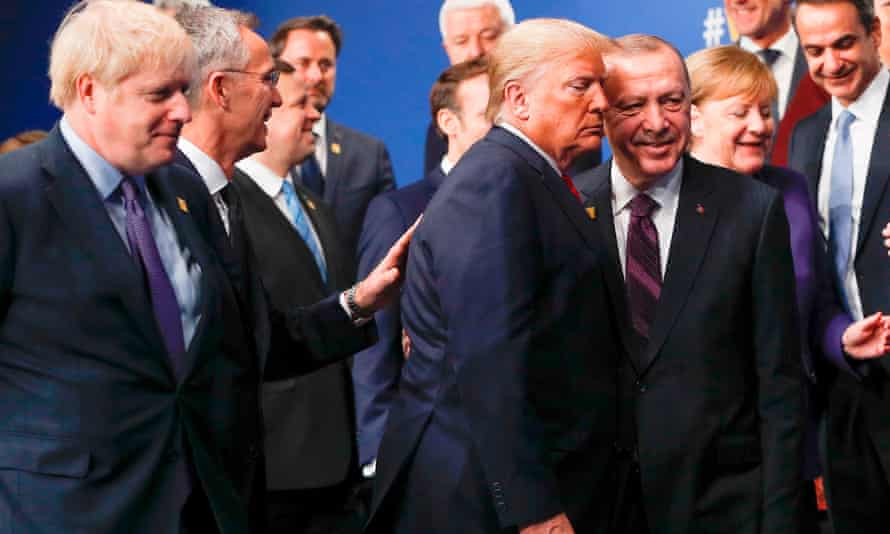 Donald Trump and Recep Tayyip Erdoğan get close at the summit in Watford.