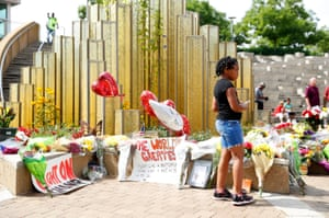 Mourners gather at a memorial outside the Muhammad Ali Centre in Louisville, Kentucky