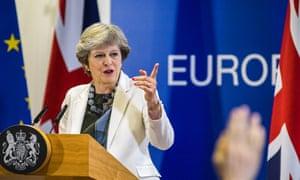 Theresa May at podium in Brissels