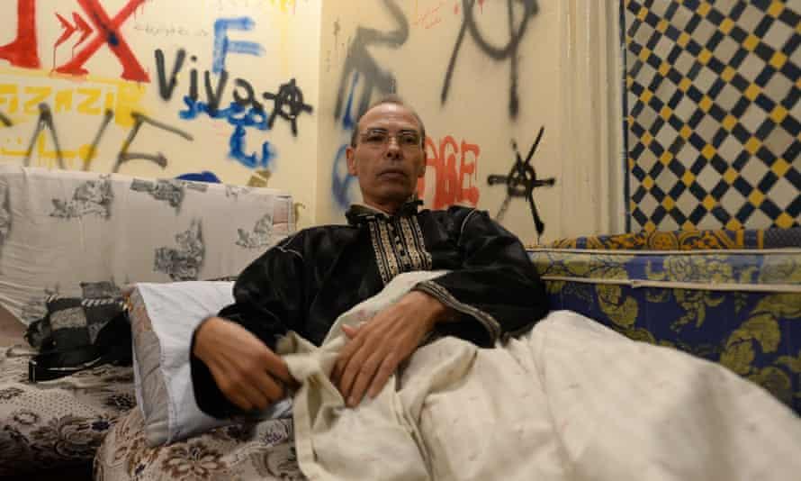 Maati Monjib lies on a bed