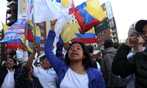 Supporters of Guillermo Lasso protest near the headquarters of the National Electoral Council in Quito.