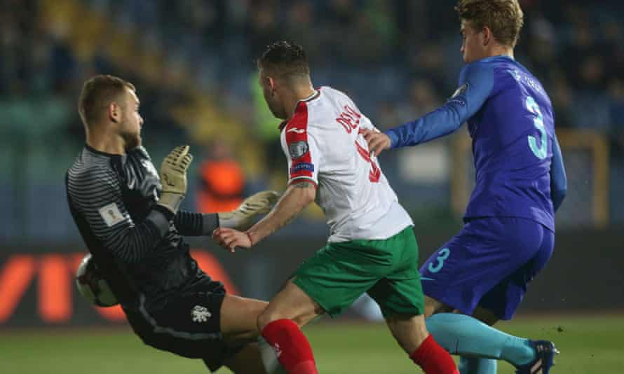 Bulgaria's Spas Delev steals in in front of the Holland defender Matthijs De Ligt to score Bulgaria's first goal in what was a miserable first cap for the young Dutch player in Sofia.