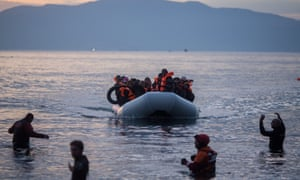 Refugees arrive on the Greek island of Lesbos from Turkey.